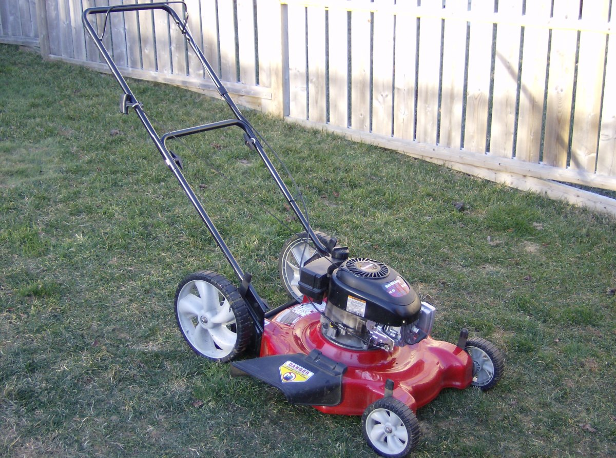 This common push mower has settings that let you raise and lower the mowing blades. By the height of the grass in this photo, you can tell its current setting is low.