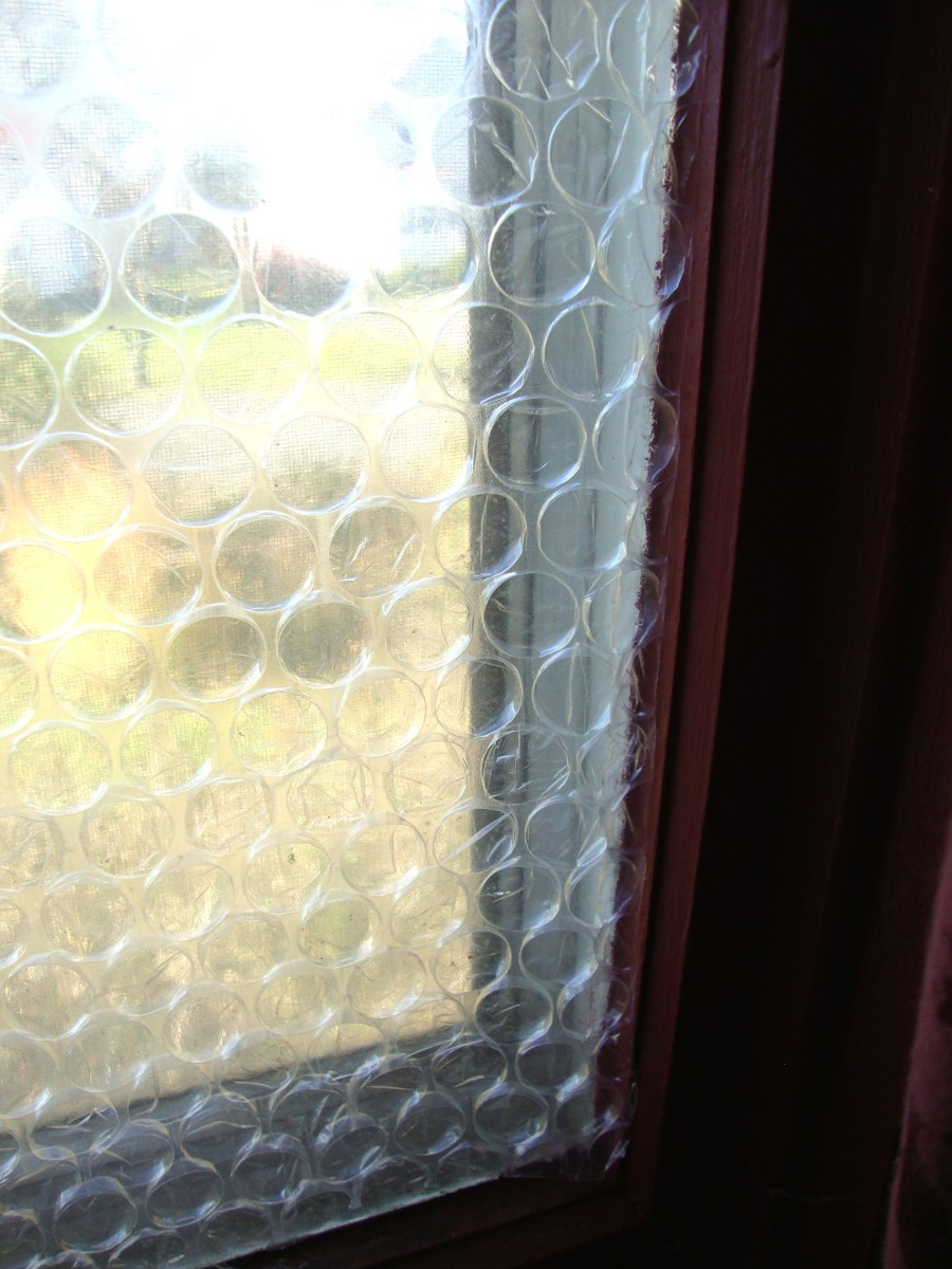 An old-style, single-pane window covered in bubble wrap.