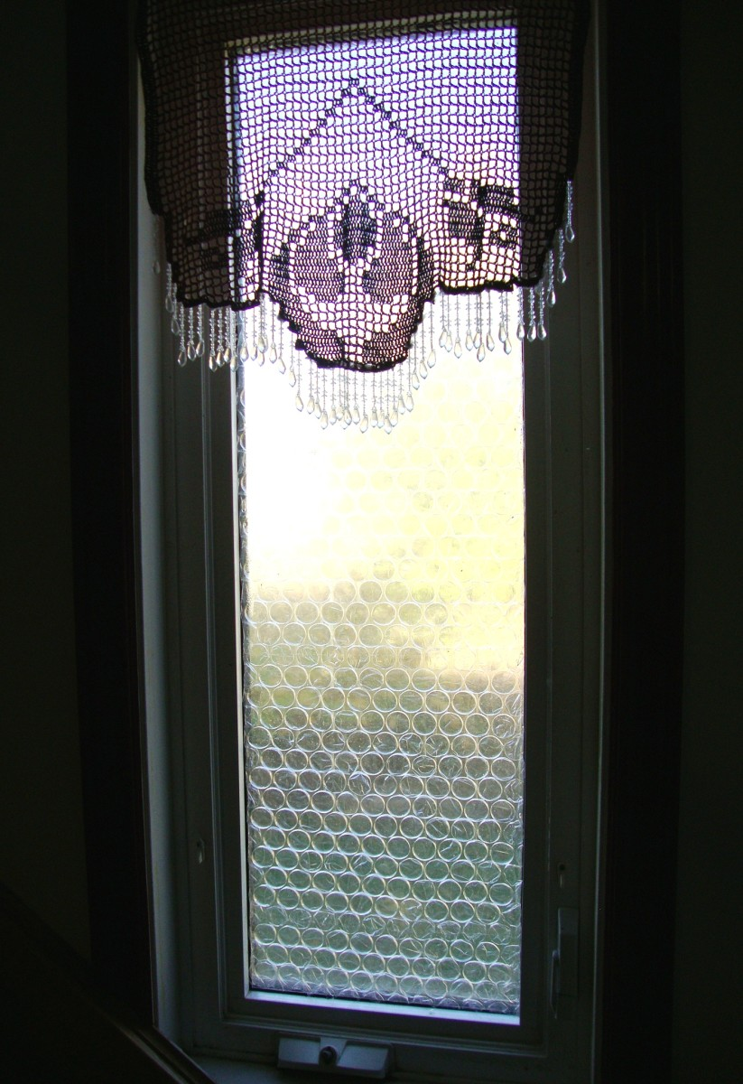 A double-paned window covered in bubble wrap. Nice and snug for winter!