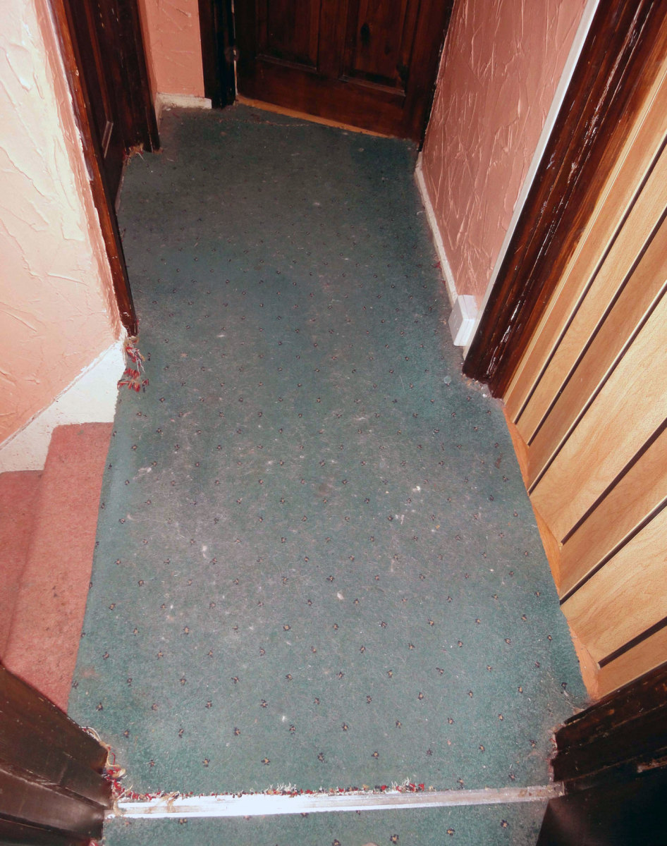 The old carpet on the upstairs landing