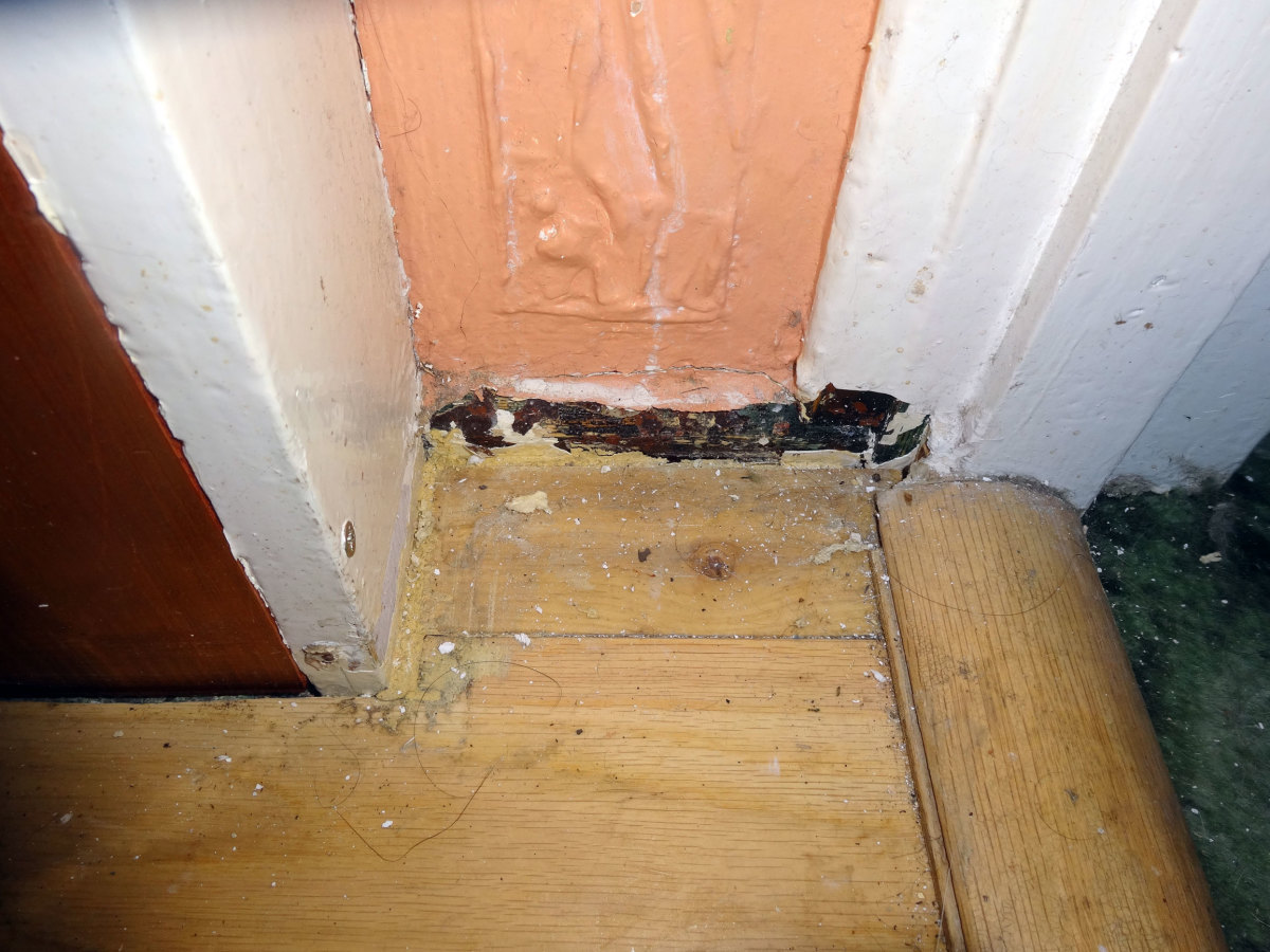 Close up view of the old skirting board by the living room door