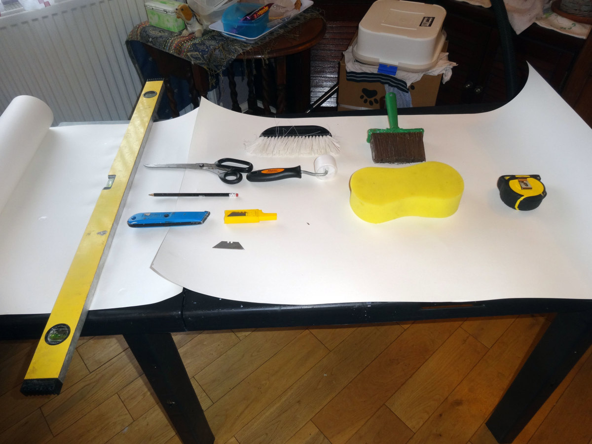 Tools used for wallpapering:  paste table, straight edge, tape measure, pencil, Stanley knife and spare blades, decorating scissors, paste brush, wallpaper brush and roller, and decorator's sponge