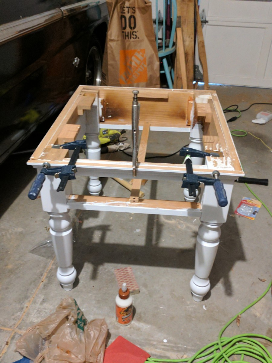 Using clamps and wood glue, I put the table back together and left in the sun to dry before reattaching the table top.