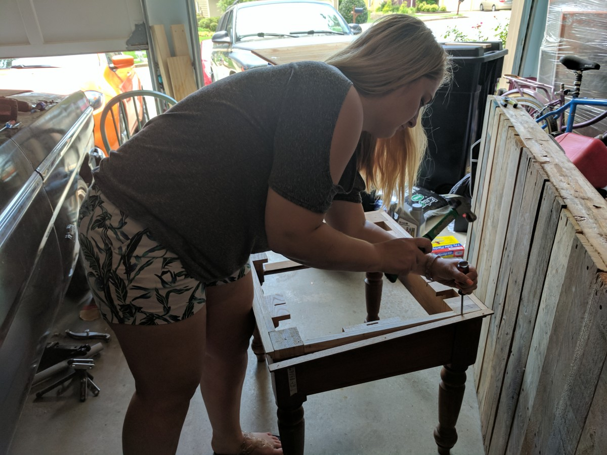 Taking apart the table so I can paint it. You want to take apart as many pieces as possible otherwise the paint job won't turn out as well.