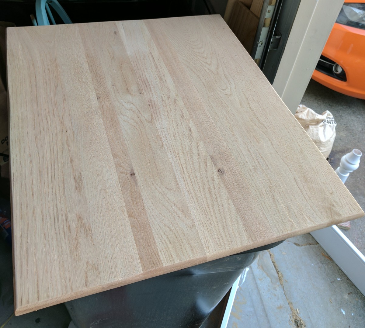 This is the table top after I belt-sanded off the old stain and then used a palm sander with a fine grit sandpaper to smooth it out before staining.