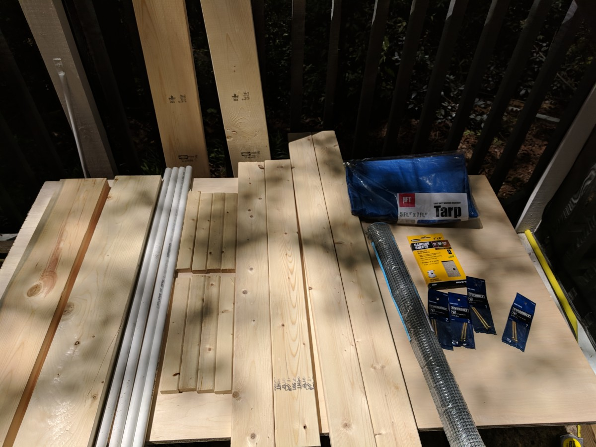 Here's all of my supplies, laid out. Since I don't have a workspace, I put my plywood sheet on the saw horses and used that as a table until I was ready to use the plywood.