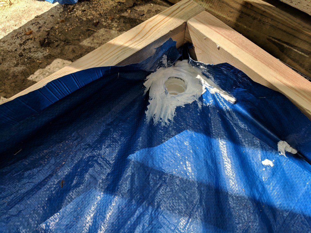here you'll see how I've sealed in my drainage pipe all the way around the opening and on the tarp.