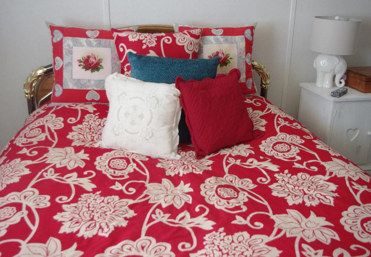 Repurpose your extra pillows to lengthen your duvet.