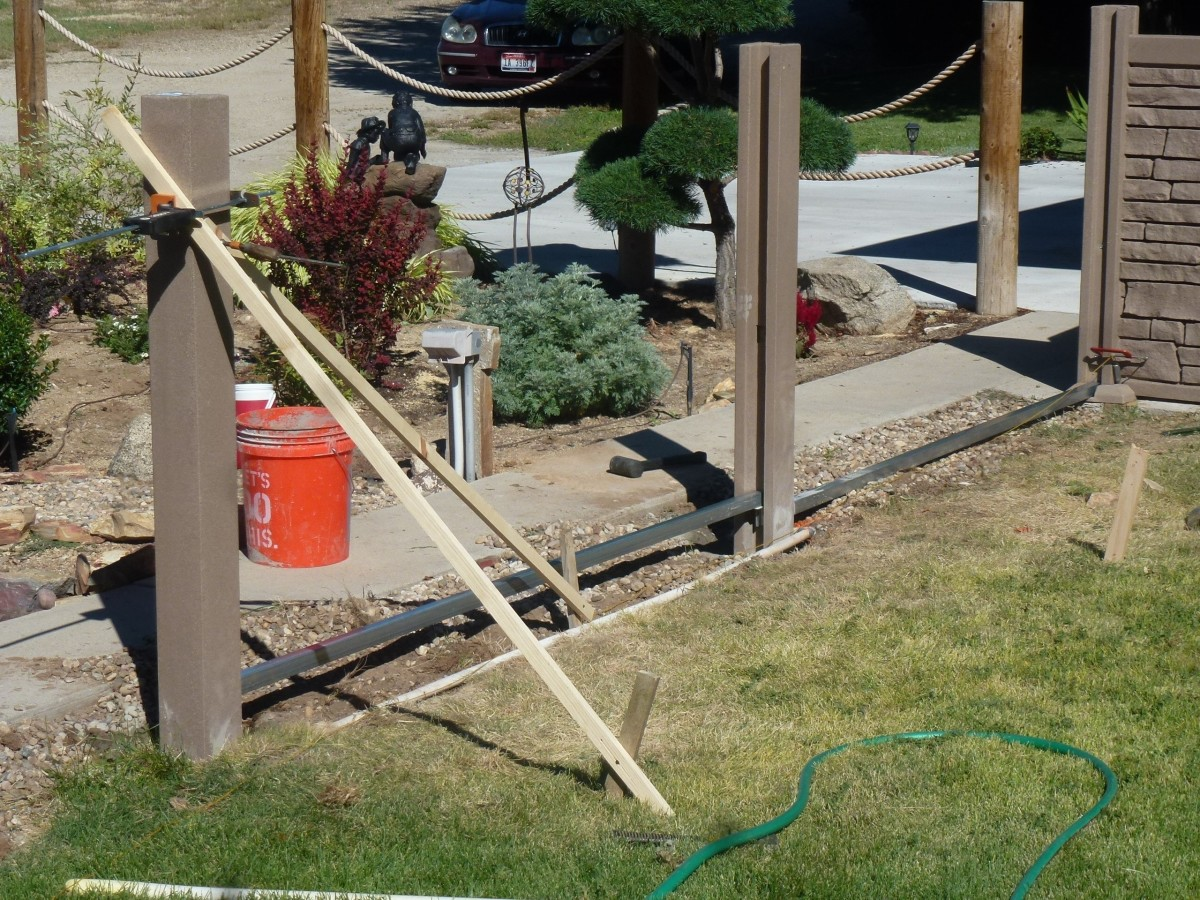 Bracing of the post.  Braces are run two different directions.  The stiffeners are not at the same height as the fence rises on this panel.