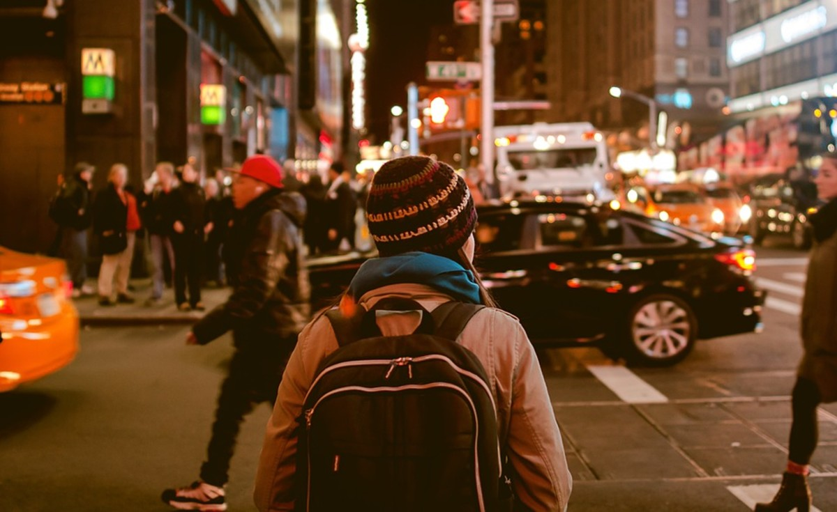 If you walk or ride the bus a lot, it's a good idea to carry a knapsack on your back. Not only will you have ID with you, but you can also carry books, a kindle, a tablet to write, or a laptop. Plus you'll have a bag handy, if you decide to shop.