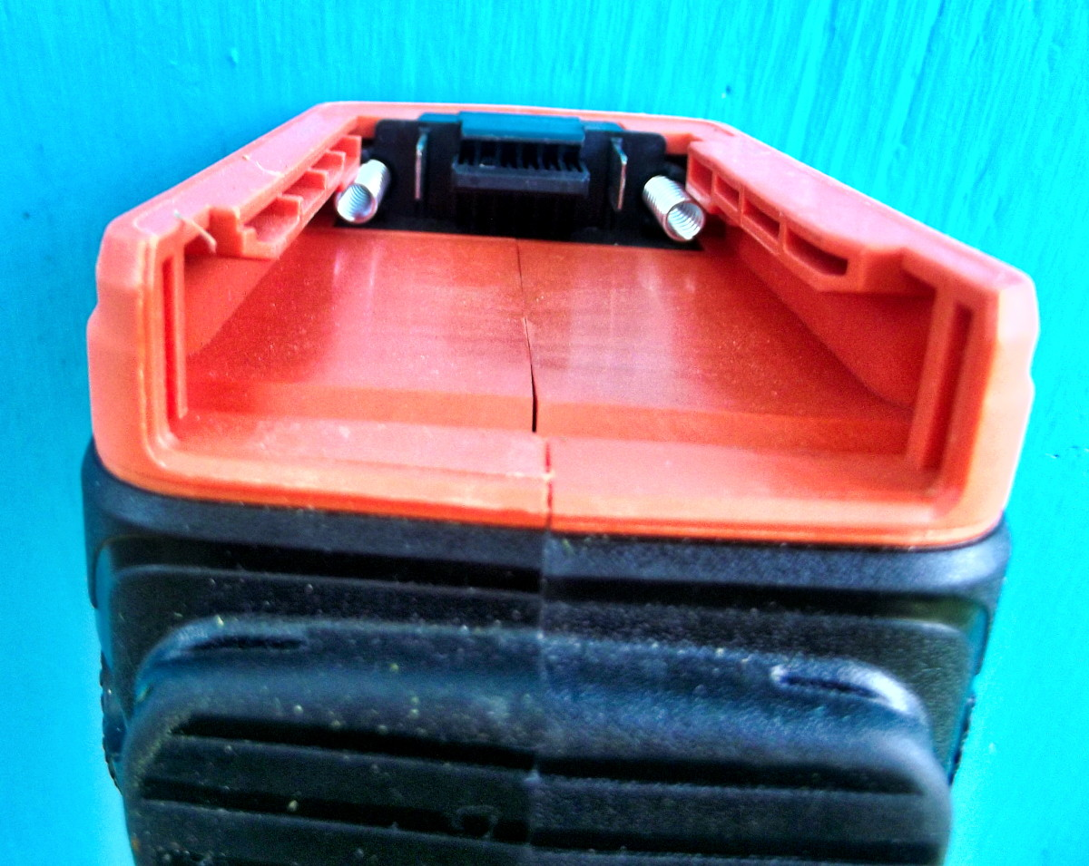 Battery compartment is located at the top of the Black & Decker LST540 Brushless String Trimmer.