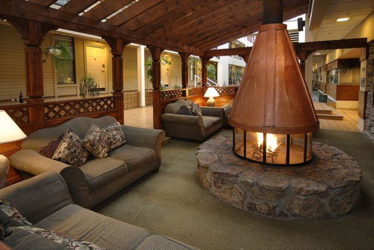A huge round fireplace in the middle of the living space isn't a good idea.
