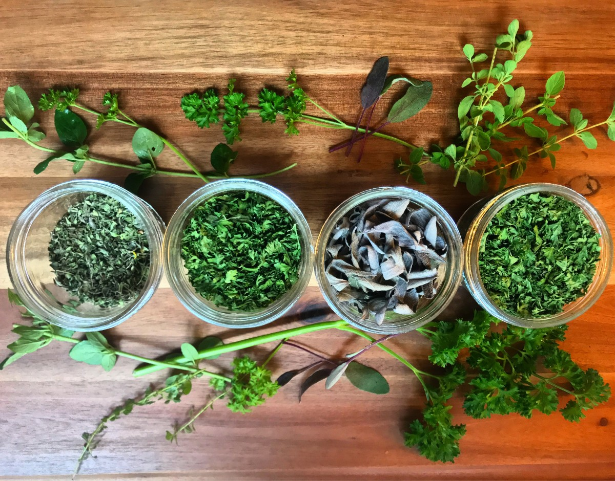 Herbs completely dried and stored in mason jars.