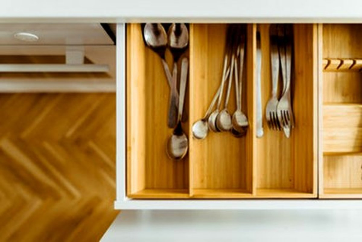 Customized utensil inserts are great but costly. Use expandable silverware organizers to save money.