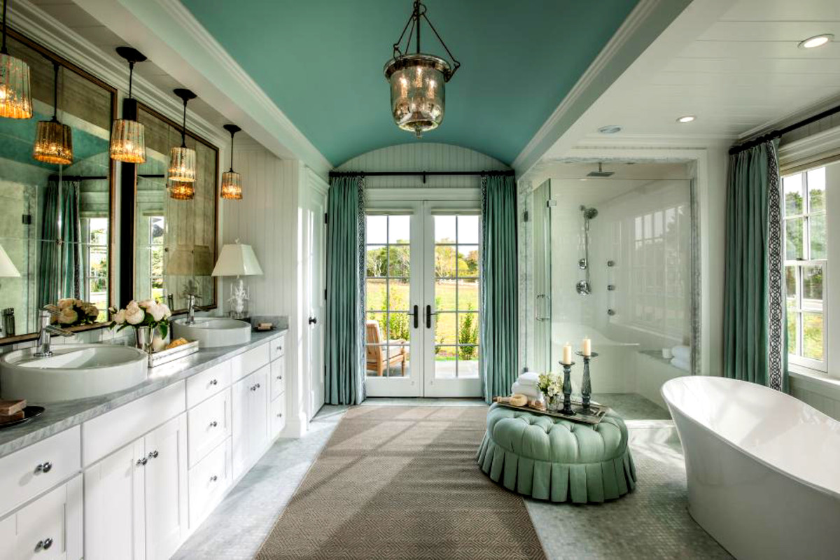 Sea blue gives this luxurious bathroom a coastal feel.