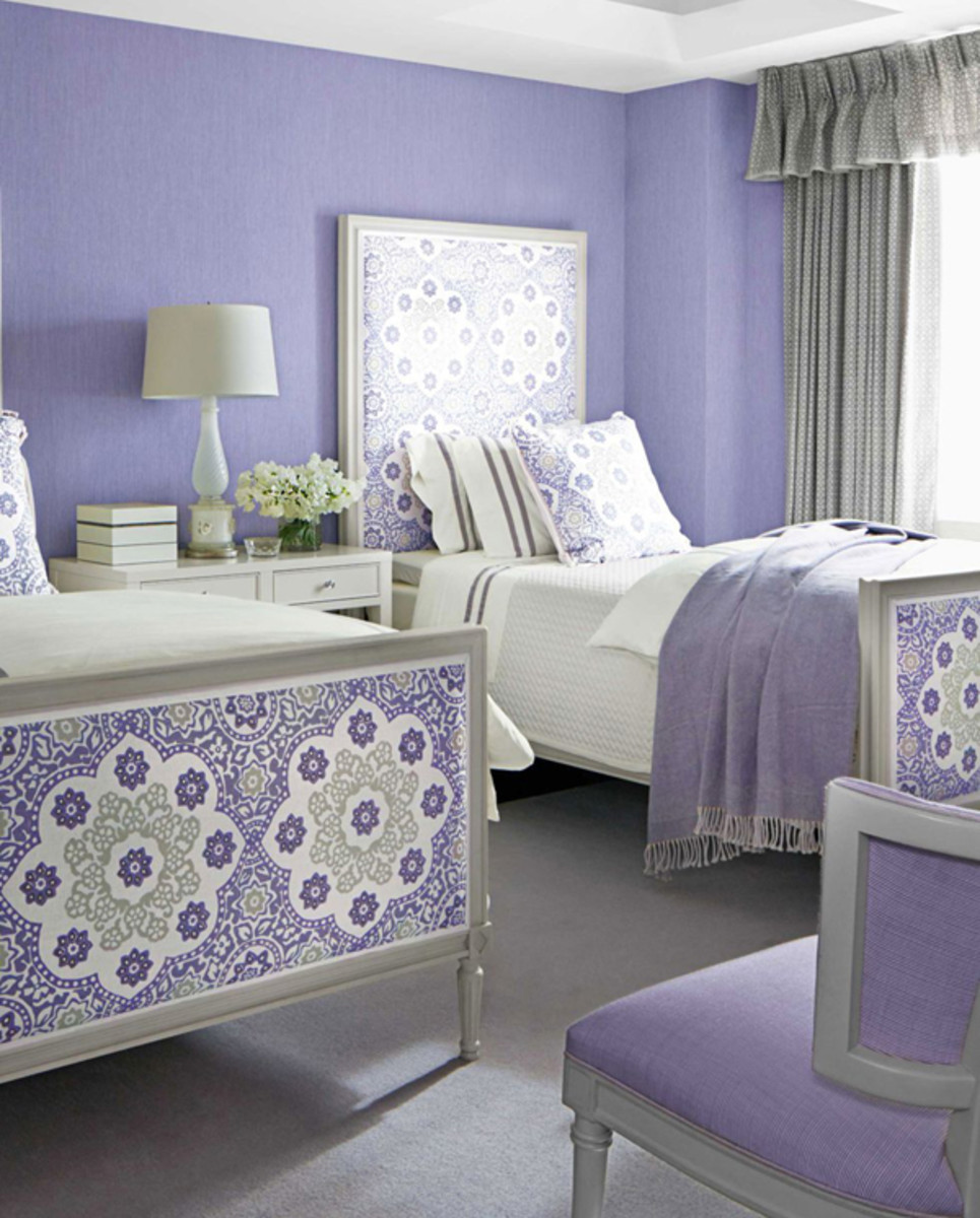The contrast of white accents against purple walls make for a classic bedroom.