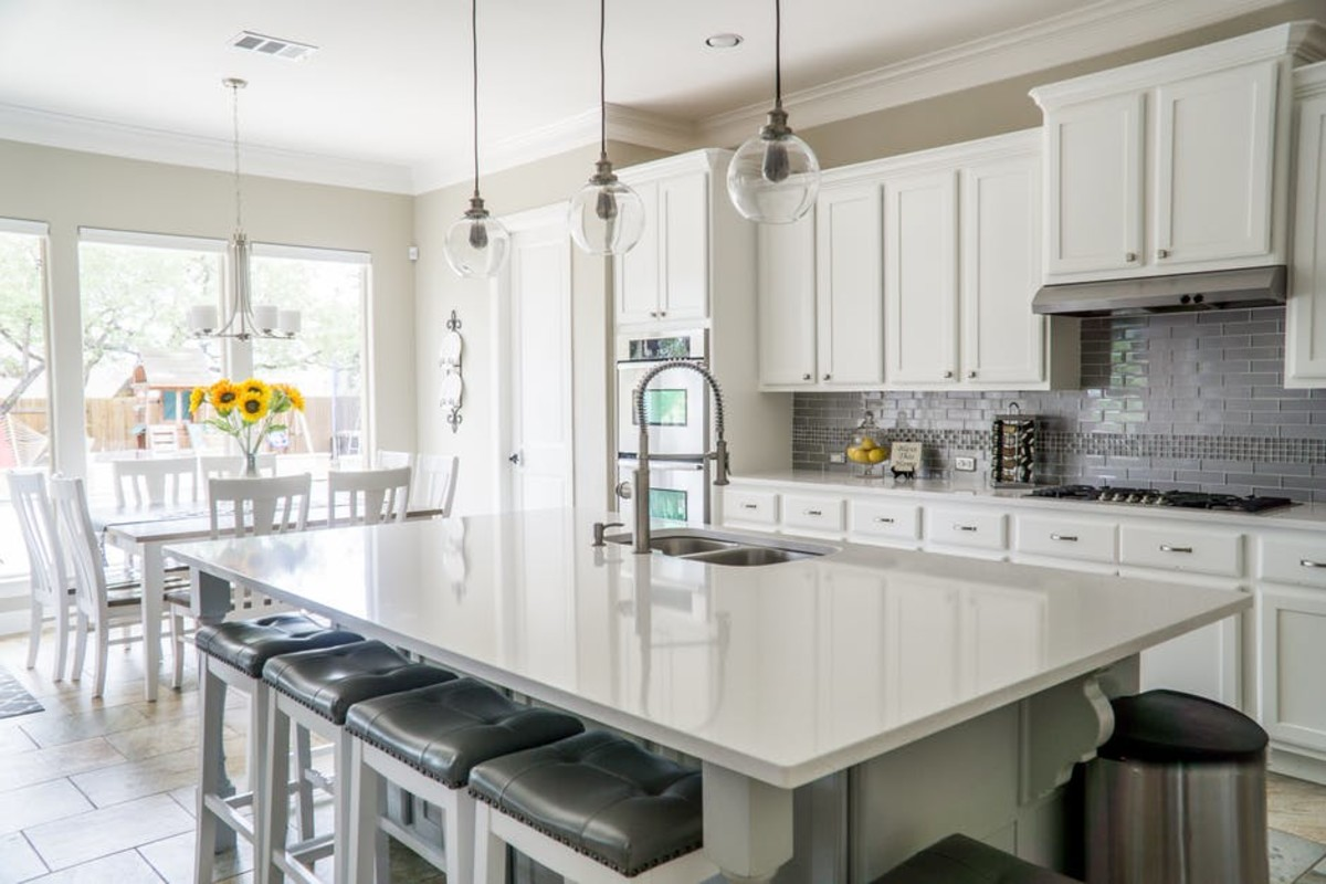 Use lots of white in kitchens and bathrooms for a fresh and clean appearance.