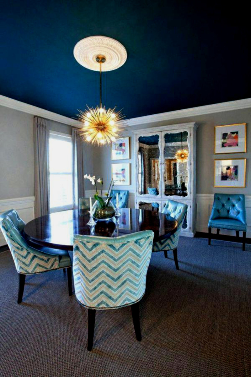 This deep blue definitely makes this large dining room much more cozy.