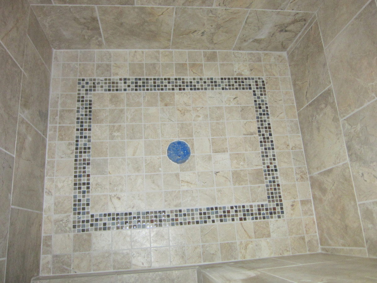 A properly sloped shower floor never puddles or holds water.