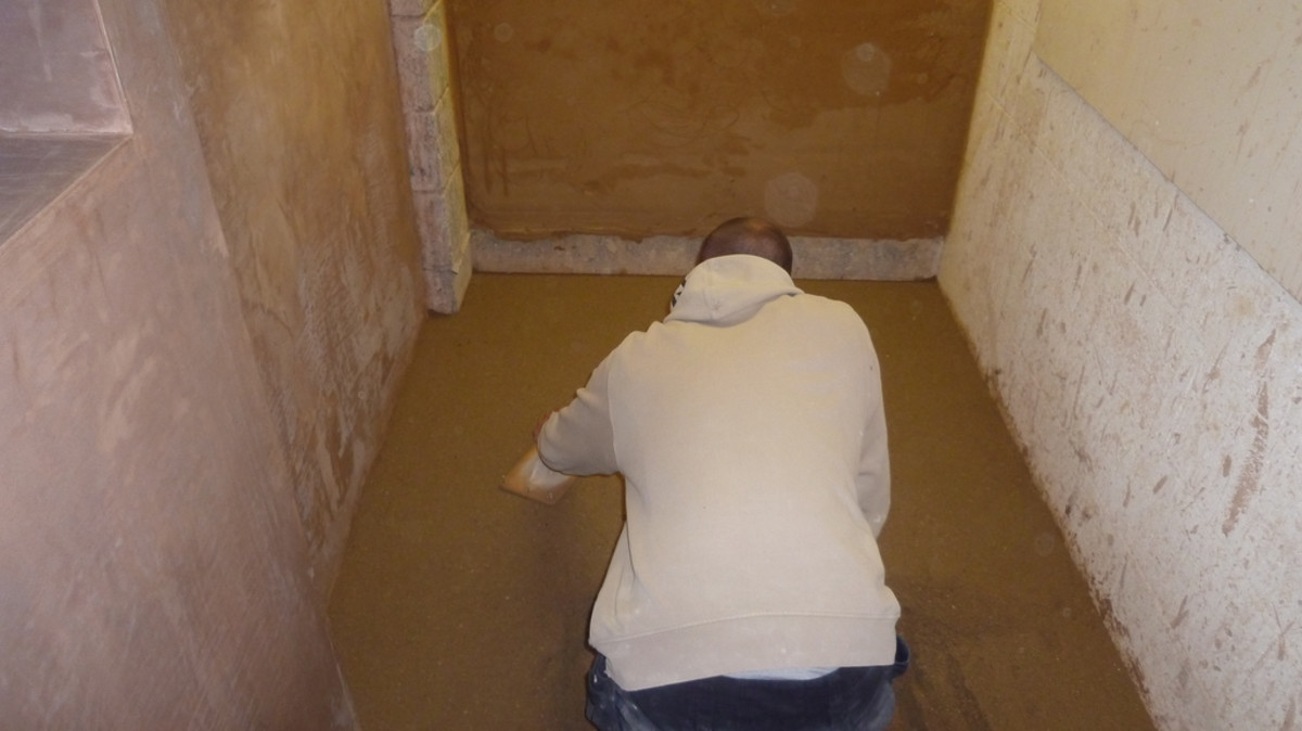 Dry pack the shower floor with either a grout float or a flat trowel.