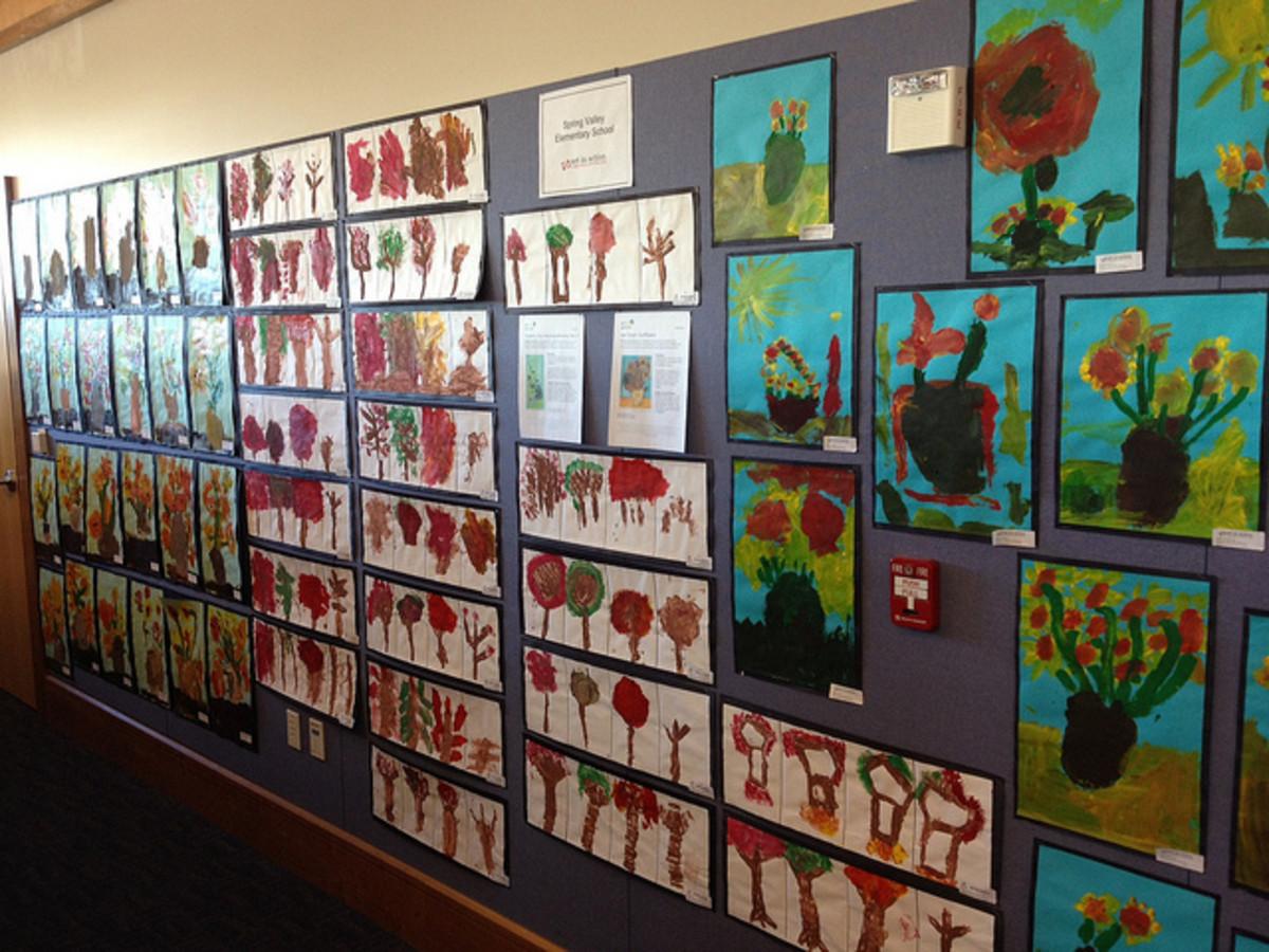 Inexpensive family artwork brightens up a dark hallway.
