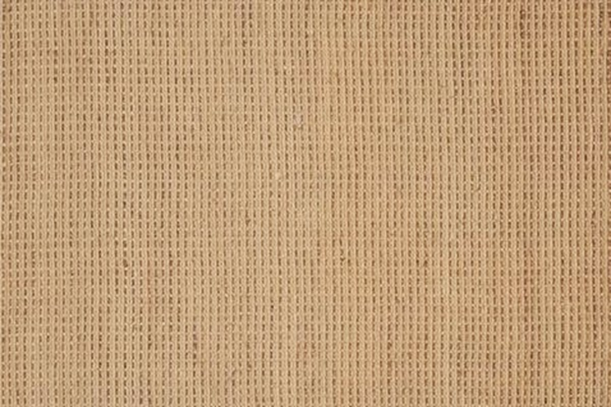 A waffle-weave sisal rug provides a tailored look for any room.