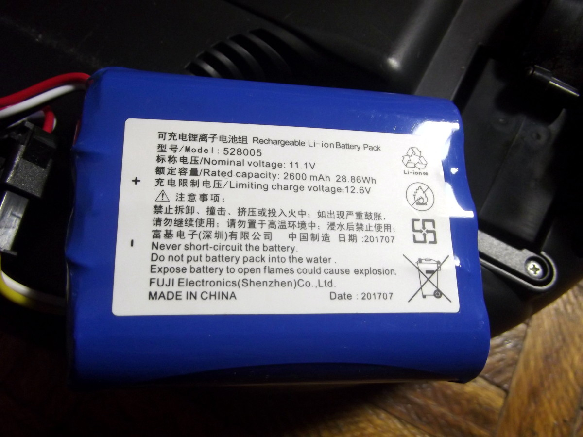 Battery of Kobot RV353  Robotic Vacuum is located in compartment beneath the unit