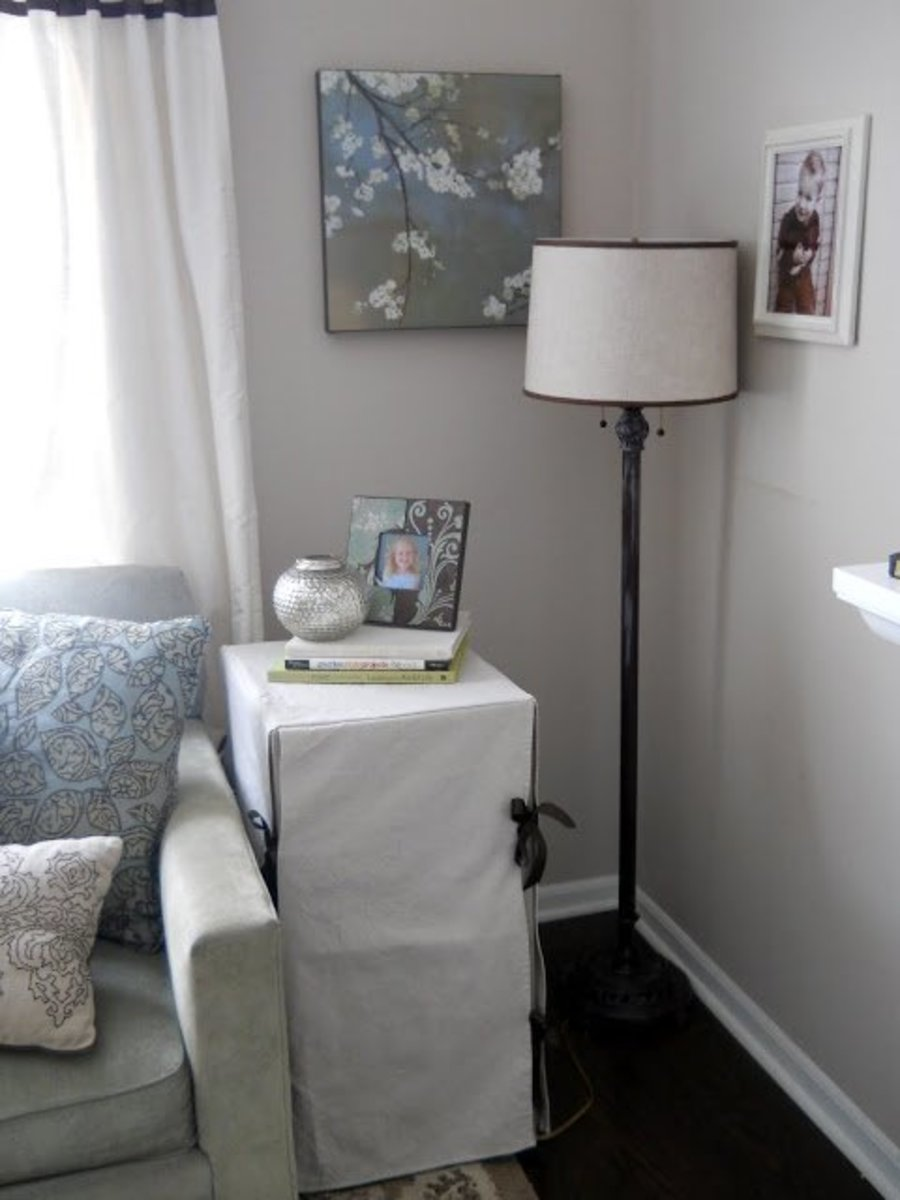 A simple slipcover can convert a banged up filing cabinet into a stylish end table.
