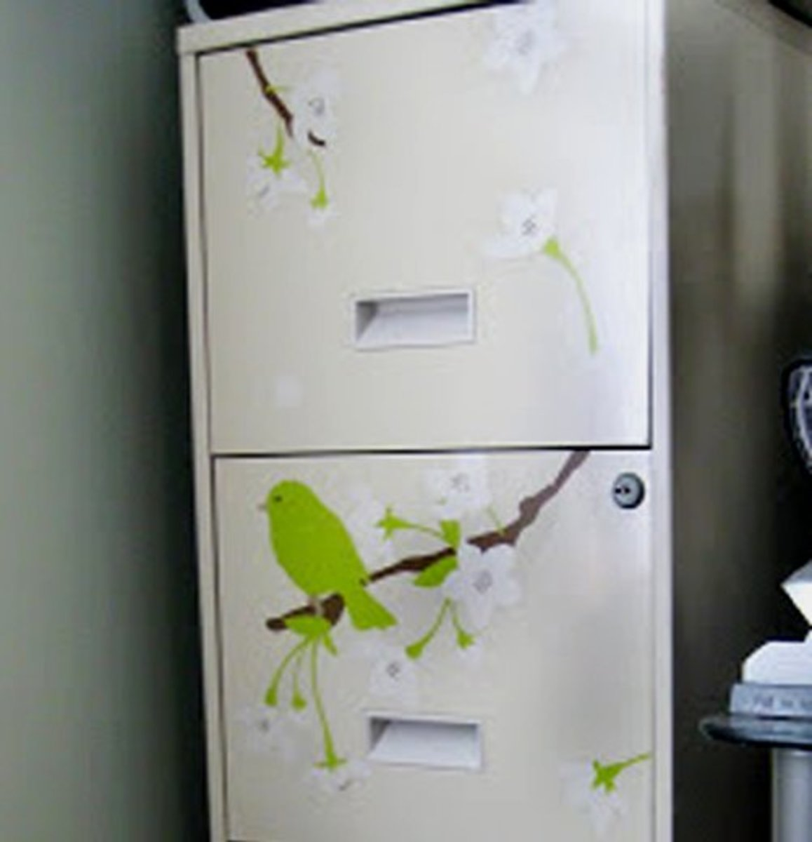 Delicate decals makeover a boring gray filing cabinet into a creative office focal point.