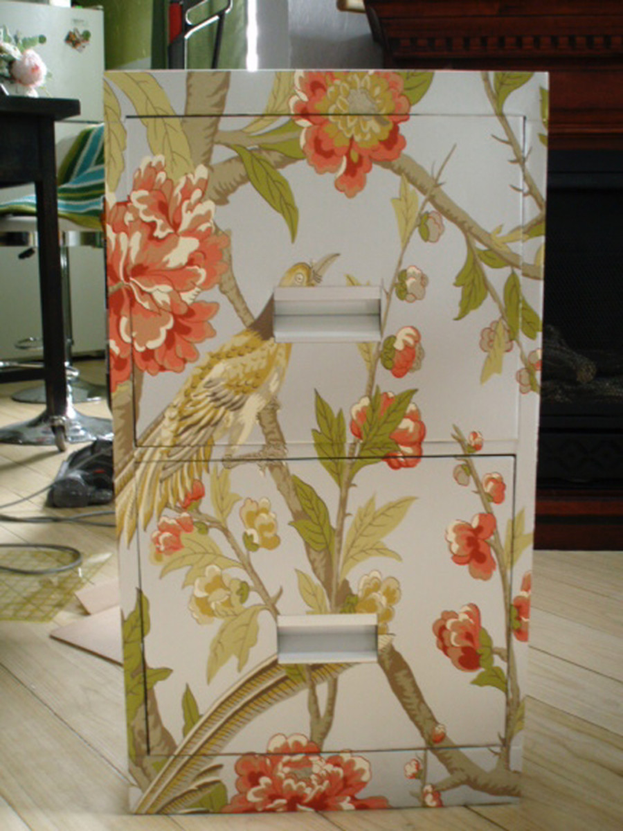 Floral wallpaper creates a feminine cabinet for all sorts of storage.