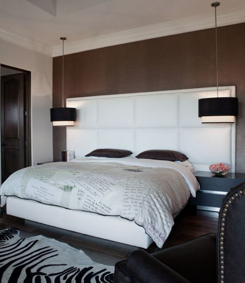 Drum pendants give off plenty of light for reading and allows more room on nightstands.
