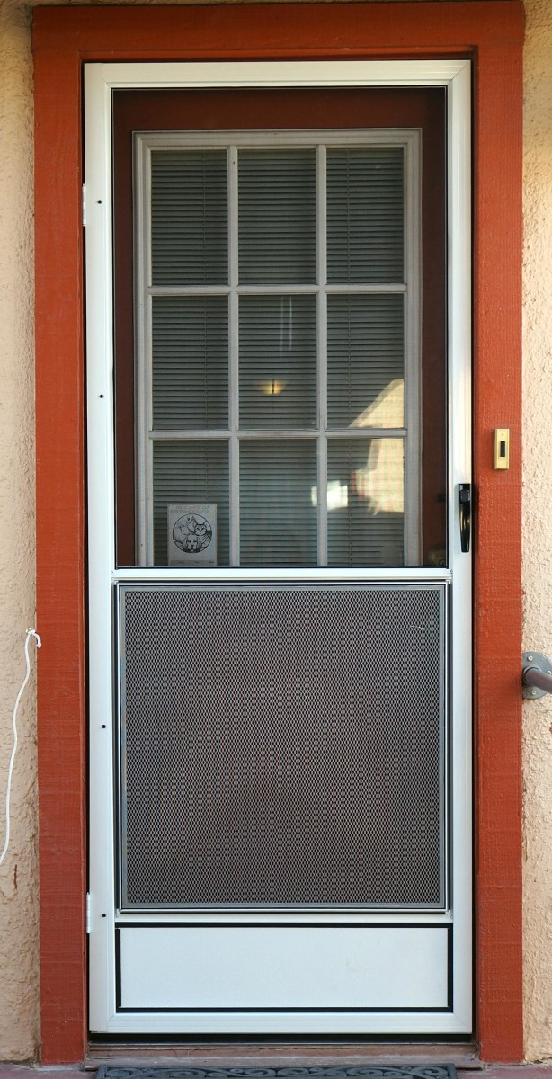 You will notice a gap at the right side of the screen, between the doorframe and the screen door; this is because the house itself is out of square.  A level placed on the mid-bar of the screen showed it to be installed perfectly straight and level!