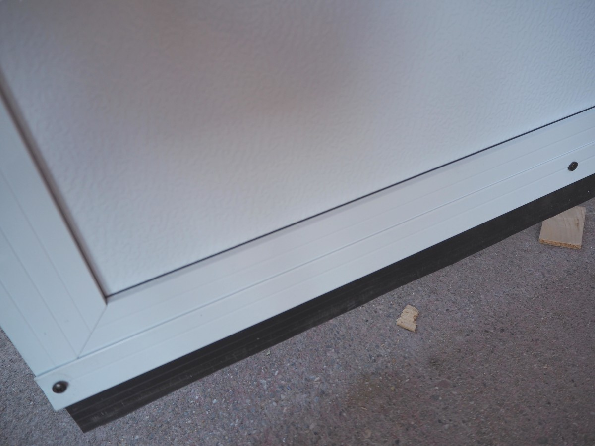 The sweep shown installed on the door