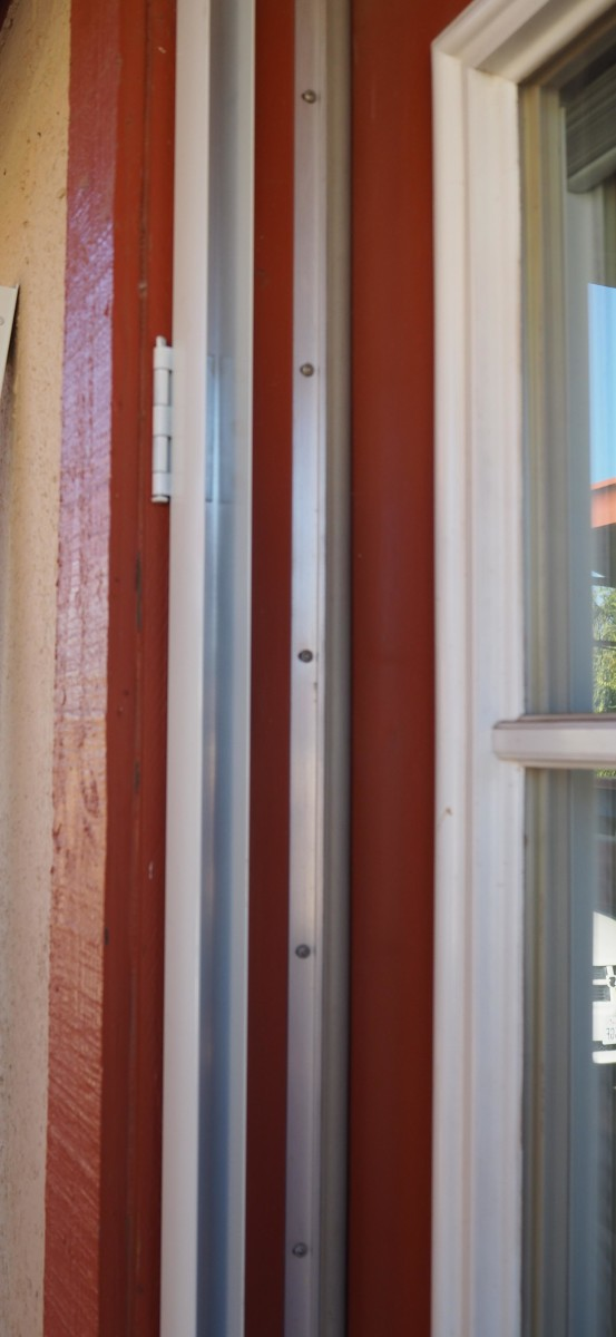 The hinge panel is removable from the door, for choosing which side you want it to swing