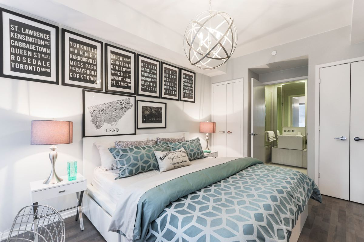 Metallic lighting fixtures give the room a sparkle that contrasts against the textural hard surface flooring.