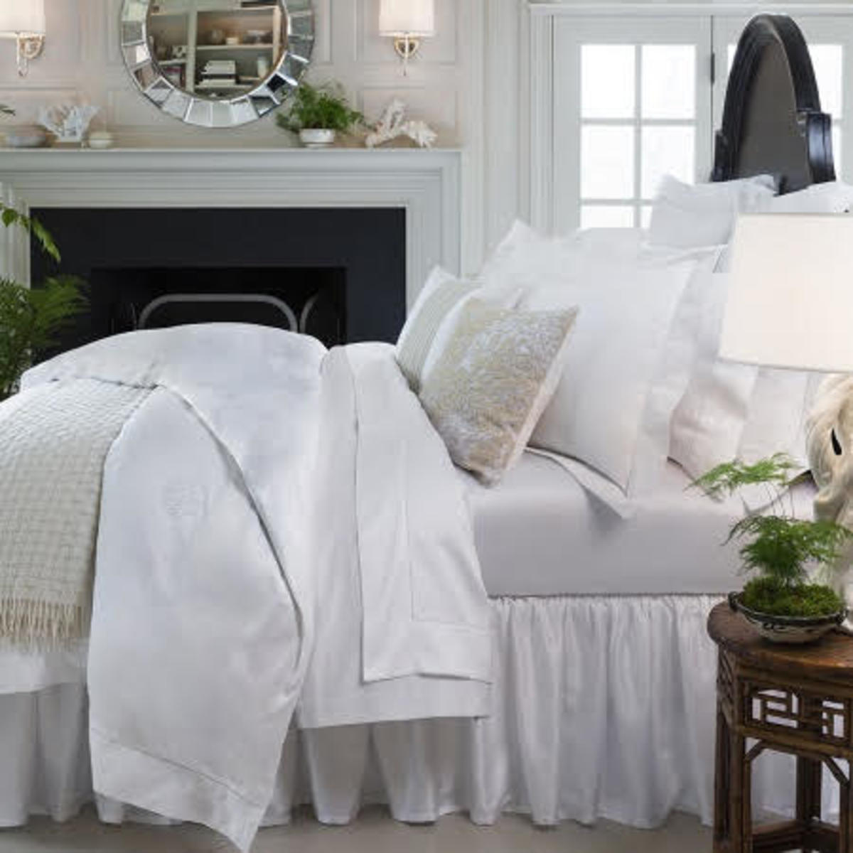 Luxurious bed linens add an elegant touch to the bedroom.