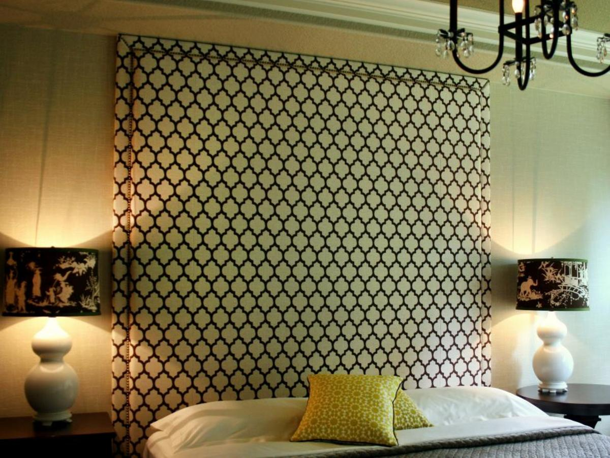 A towering headboard in an elegant pattern creates the main focal point in the bedroom.