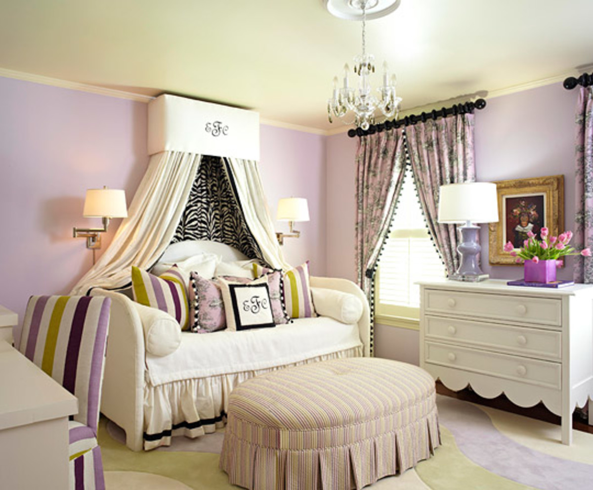 Traditional draperies paired with a bed canopy  gives the bedroom a warm, and cozy feel.