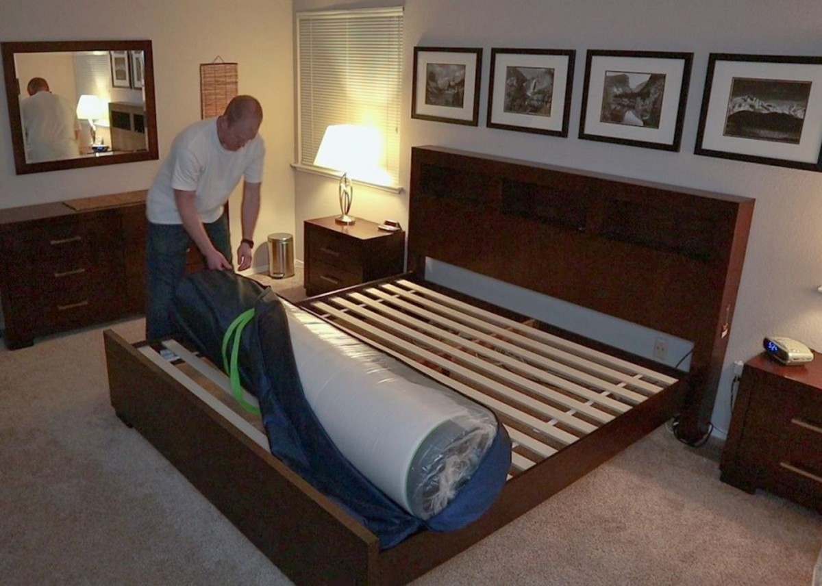 My husband unzips the inner bag after placing it on the bed, revealing the mattress inside.