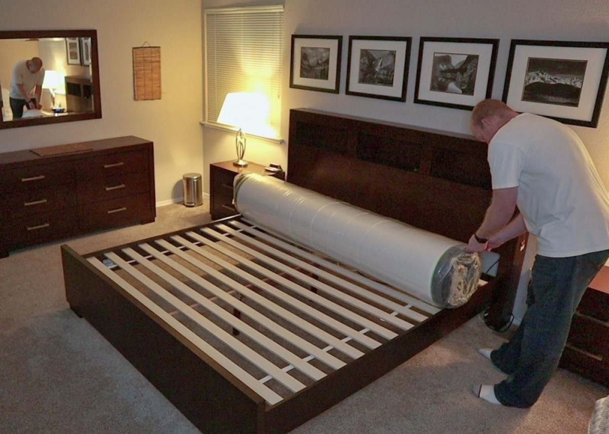 The mattress is tightly rolled and compressed inside two layers of plastic.