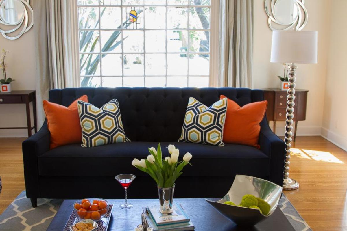 Buy an inexpensive pillow or bring one in from another room and it will add a fun pop of color to the room.