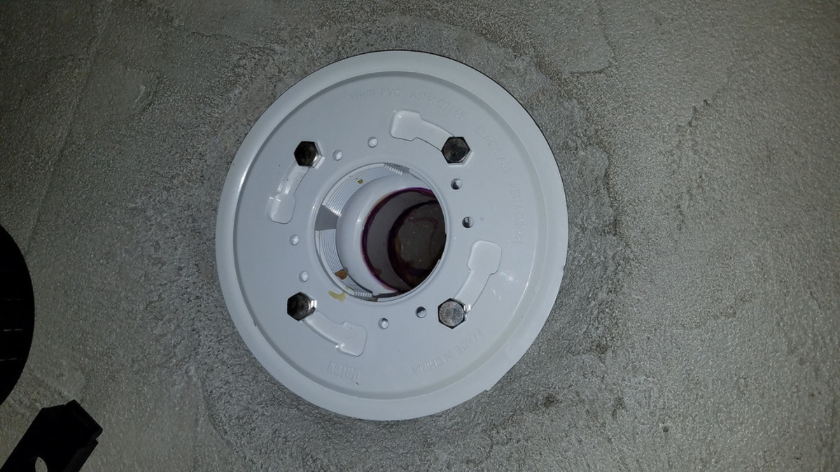 Four bolts hold the clamp ring against the flange. This model also uses 8 weep holes.