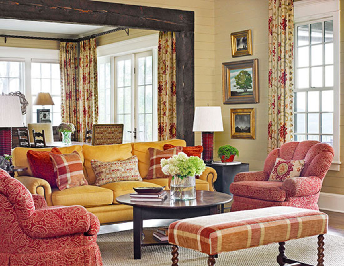 A mix of patterns in similar colors creates a a coordinated space.
