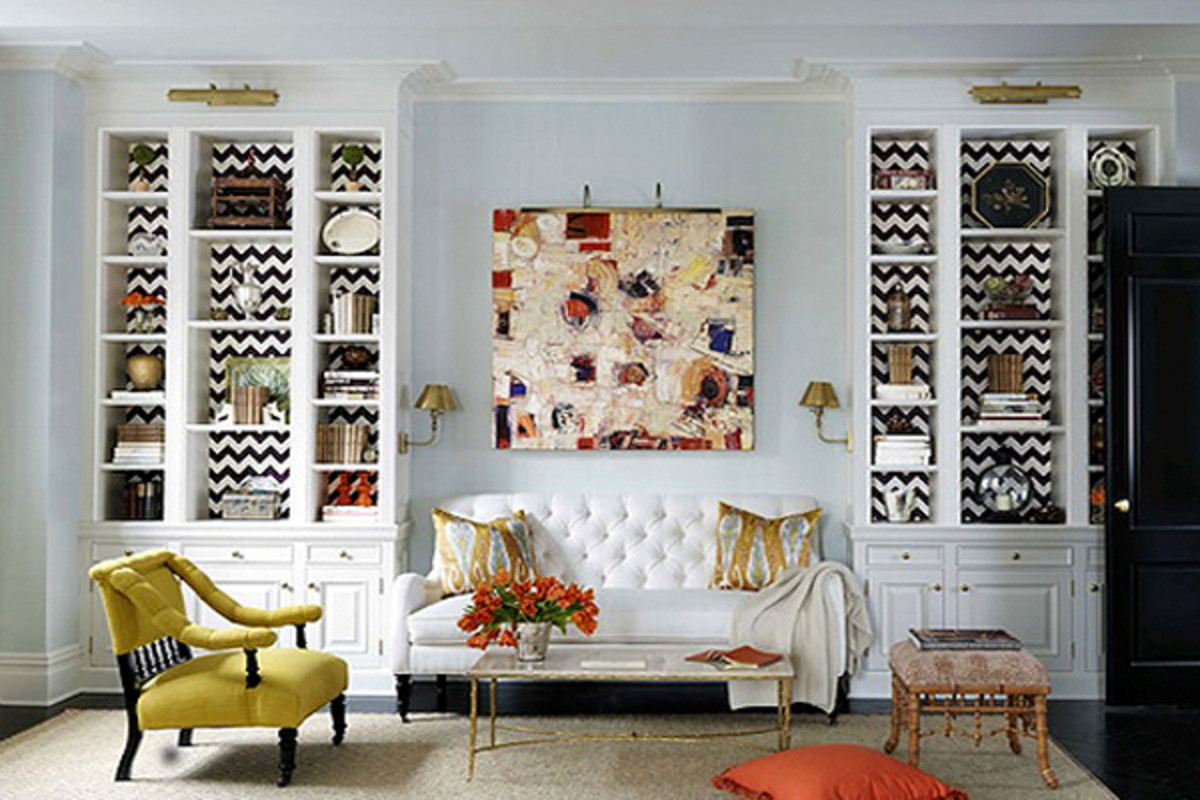 Fabric, wallpaper or paint brings out the  personality of the bookshelves.