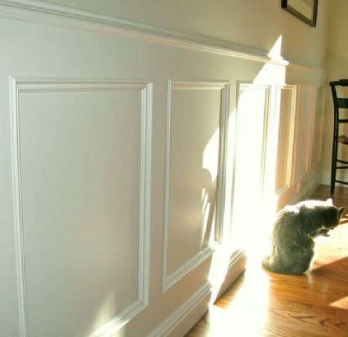 Picture molding can create wainscoting and wall frames to give a room depth and texture.