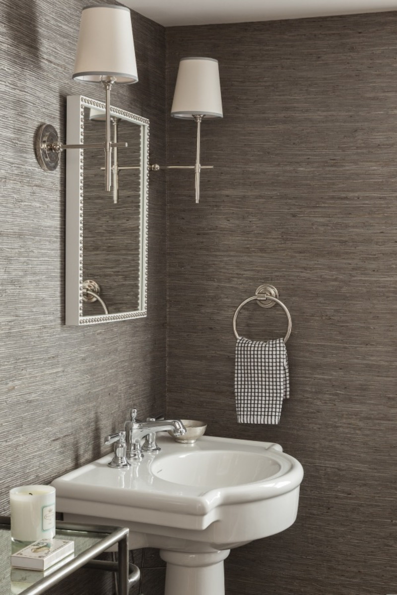 Using woven grasscloth in a powder room creates a small but mighty textural design.