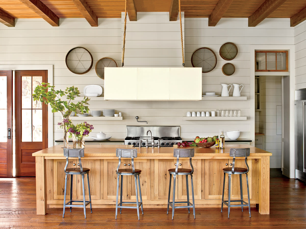Wood grain can be applied to the walls, floors, ceiling and even fronting a kitchen island.
