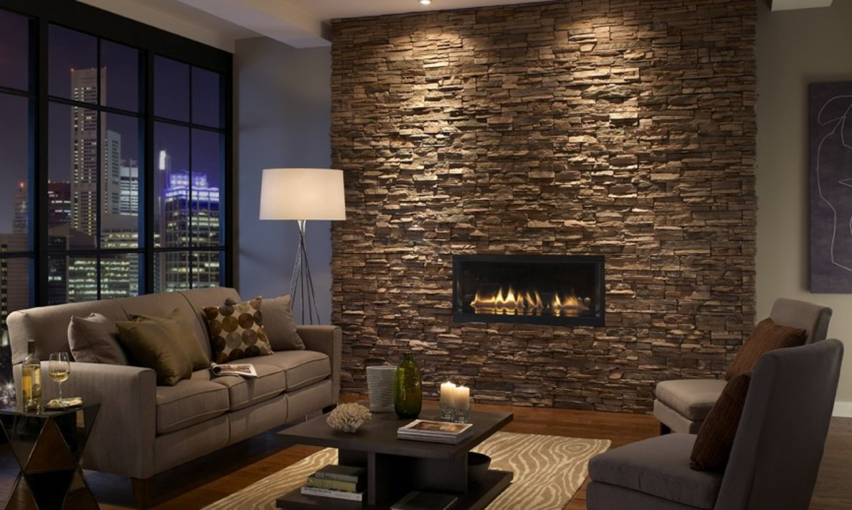 A stacked stone fireplace has a rough feel to the touch.