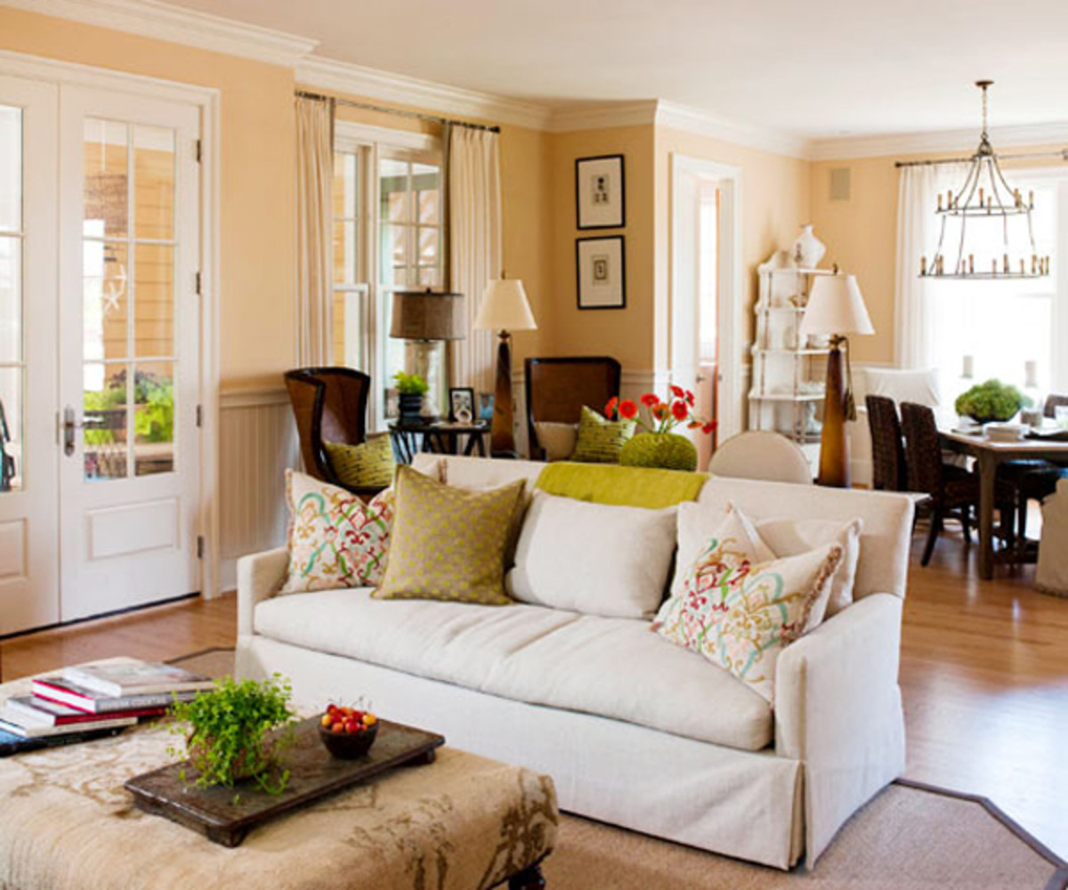 If you have an open concept home, use a piece of furniture to divide functional zones.