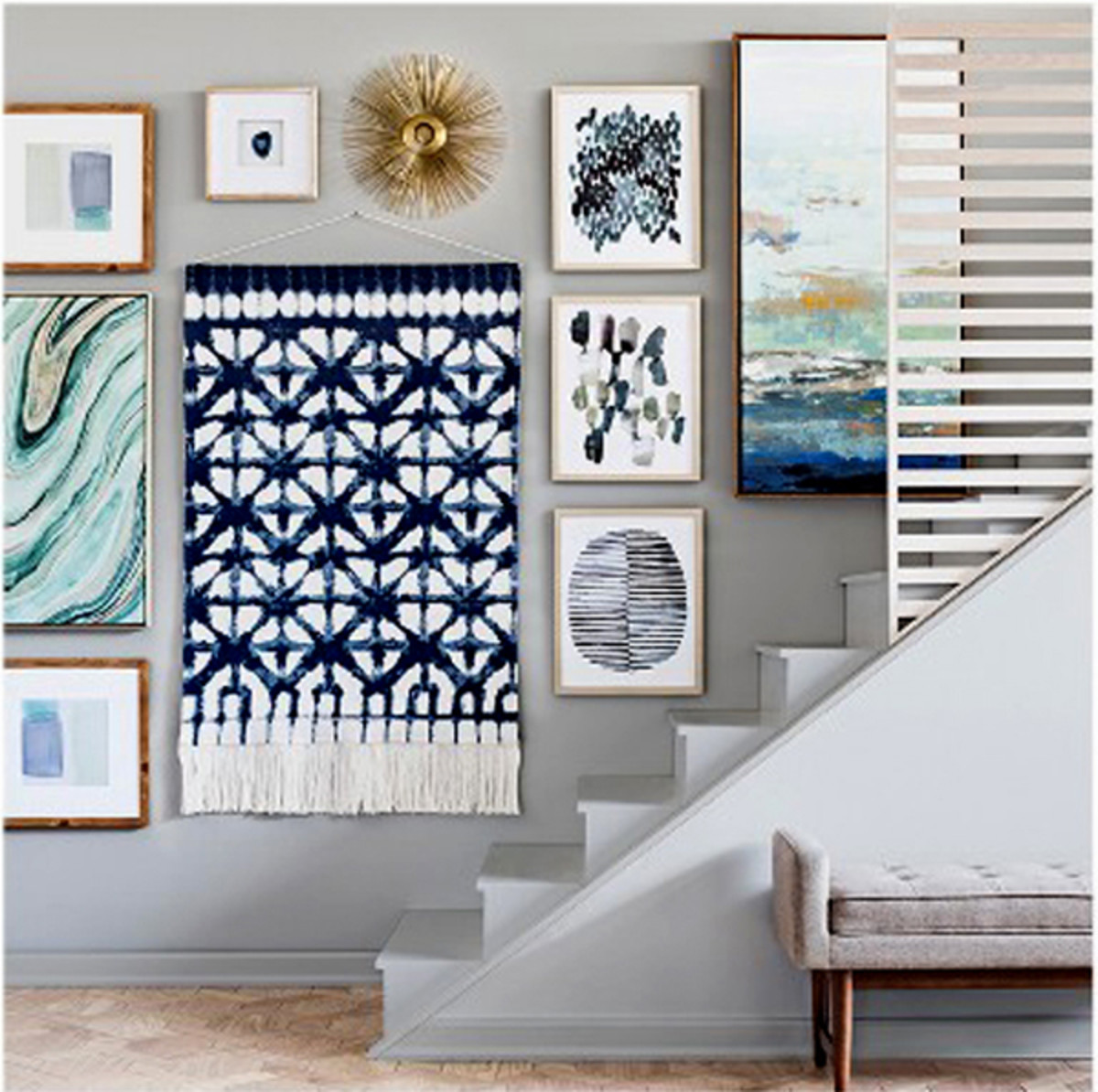Once you've placed the furniture, add artwork on the walls to help supplement the design layout.